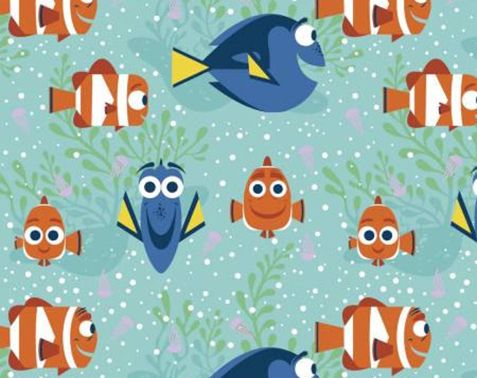 Springs Creative - Finding Dory - Dory All Smiles on Aqua Cotton Woven Fabric