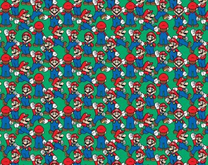 Springs Creative - Nintendo Super Mario -  Mario on Green -  Cotton Woven Fabric