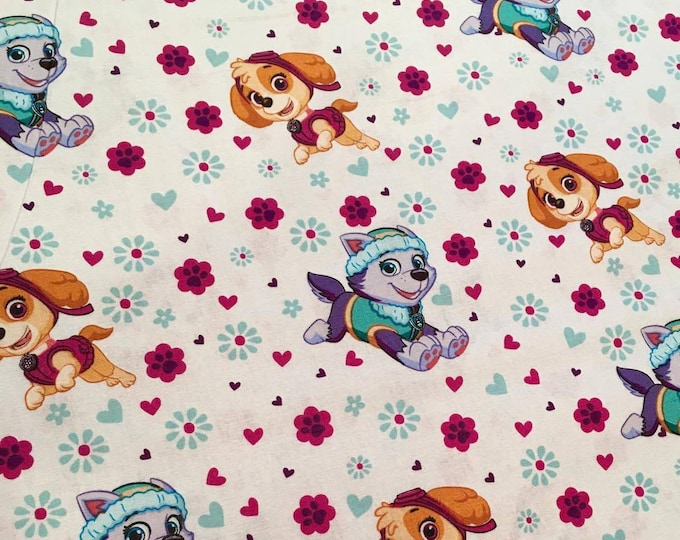 David Textiles - Paw Patrol - Skye and Everest flowers on White Cotton Woven Fabric