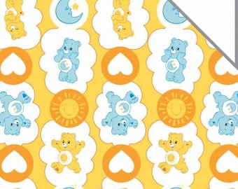 Camelot Fabric - Licensed Care Bears - Funshine Bear & Bedtime Bear on Yellow Cotton Flannel Fabric