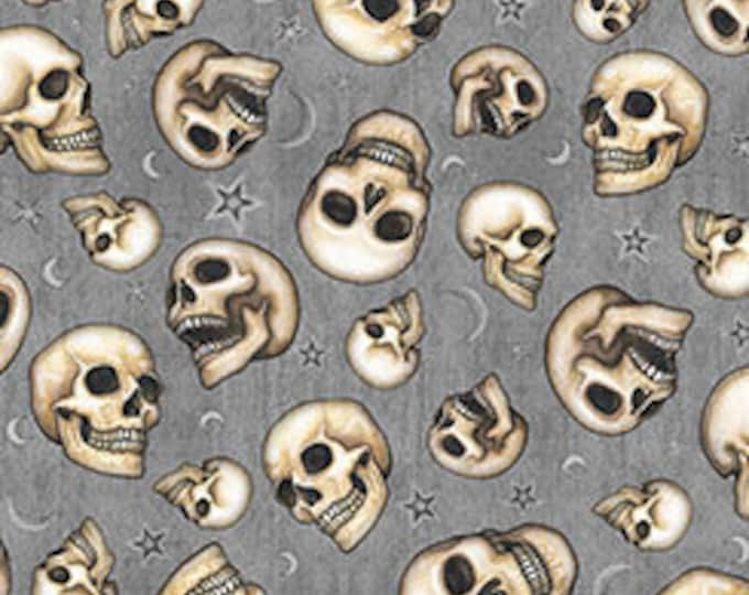 Quilting Treasures - Spellbound, Skulls on Gray cotton woven fabric