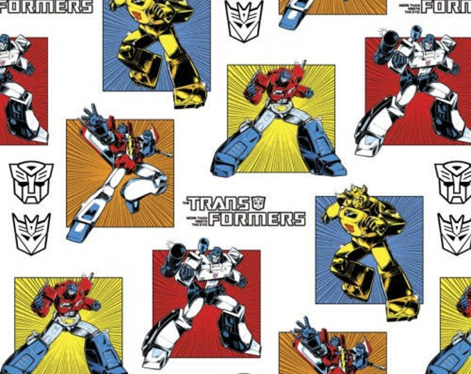 Springs Creative - Transformers - Transformers on White Cotton Woven Fabric