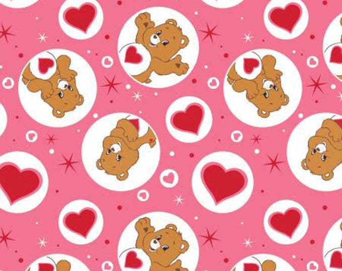 Camelot Fabrics - Licensed Care Bears -  Tenderheart Bear on Pink Cotton Woven Fabric