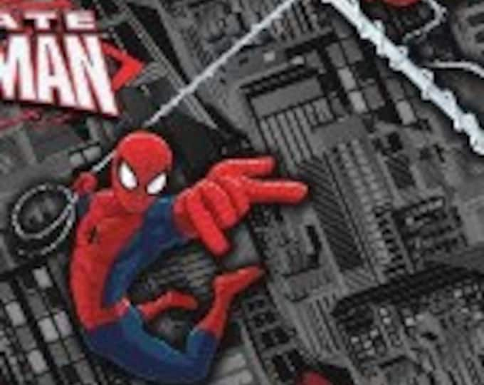 CLEARANCE -      Spiderman on Black Cotton Woven - Price per yard