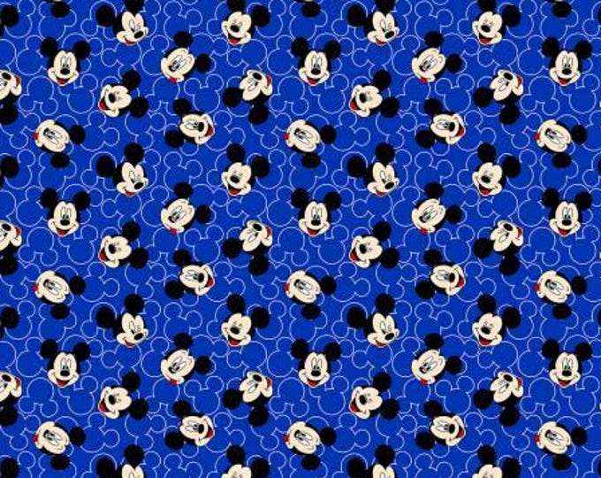 Springs Creative - Disney Mickey Mouse Face Toss on Blue Knit cotton Lycra Knit fabric