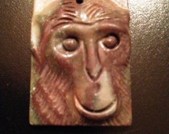 Carved Stone Pendant of a Chimp Face