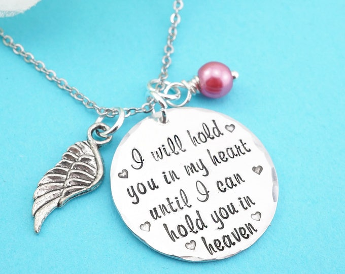 I will hold you in my heart until I can hold you in heaven hand stamped memorial necklace with angel wing and glass pearl