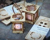 Craftsman Bungalow Luminaires.  String Light lanterns give off warm light while hanging or resting on a table. DIY kits you snap together!
