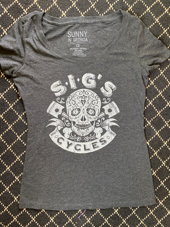 SIG'S cycles women's scoop neck triblend tee.
