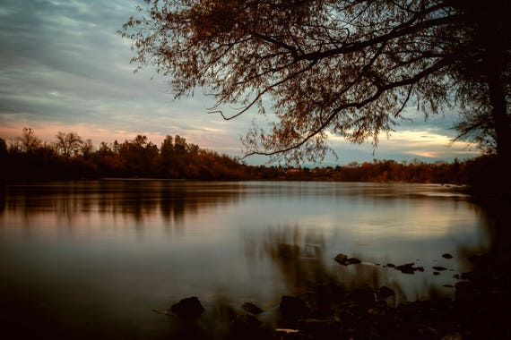 Subdued (Canvas) long exposure photograph of Sacramento River at Sunset reflections on the water