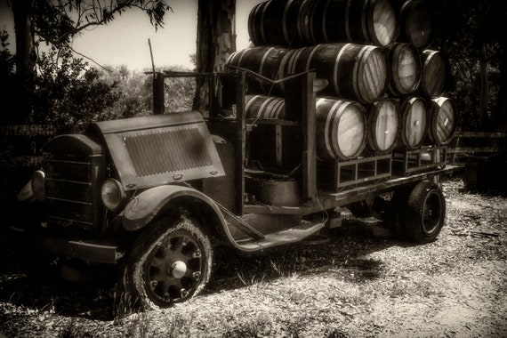 Haulin it (Metal Panel) an old wine truck loaded with barrels of wine black and white digital photograph