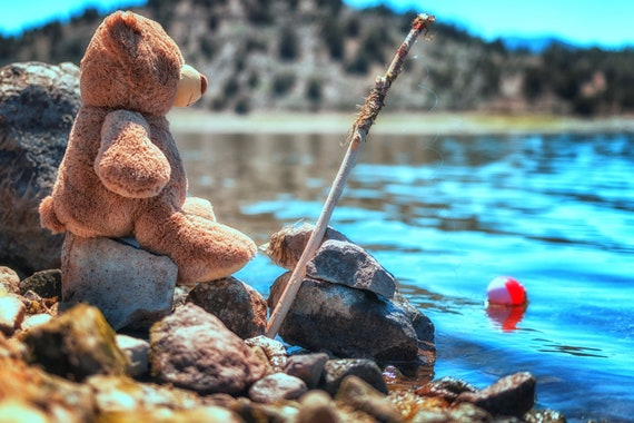 My little fishing buddy (Metal Panel) just a teddy bear fishing at the lake