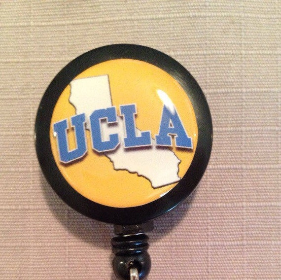 Bundle 2 Items UCLA Bruins 1 Premium Badge Reel Id Holder and 1 Metal Spinner Key Ring