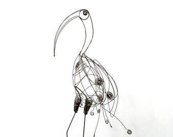 Heron in wire of vine