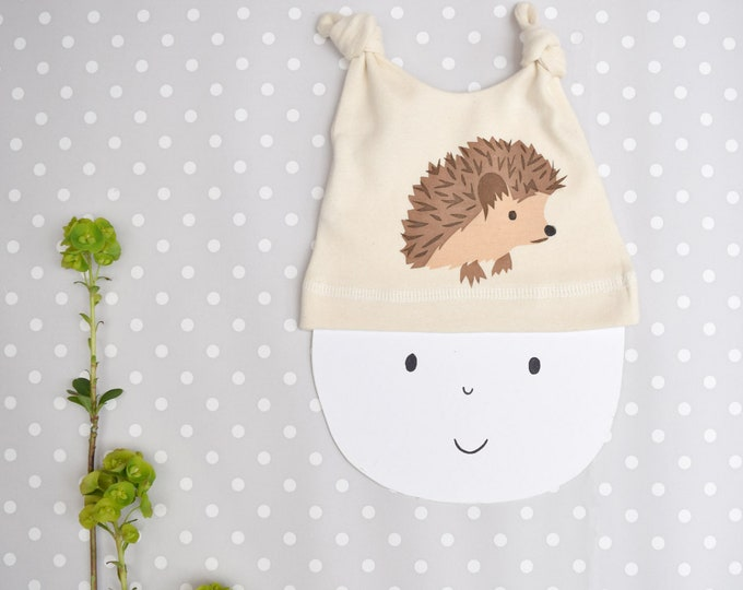 Hedgehog baby hat in organic cotton.