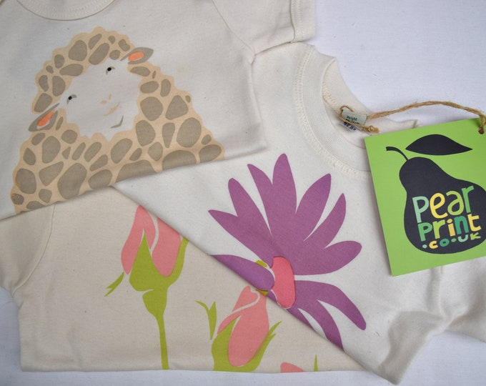 A pretty sale bundle of organic cotton baby girl clothing.