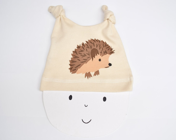 Baby hat with a hedgehog print in organic cotton from Pear Print. New baby gift. Hand printed