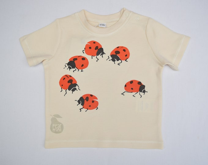 Baby t-shirt in natural organic cotton with ladybirds. Baby boy or baby girl gift.