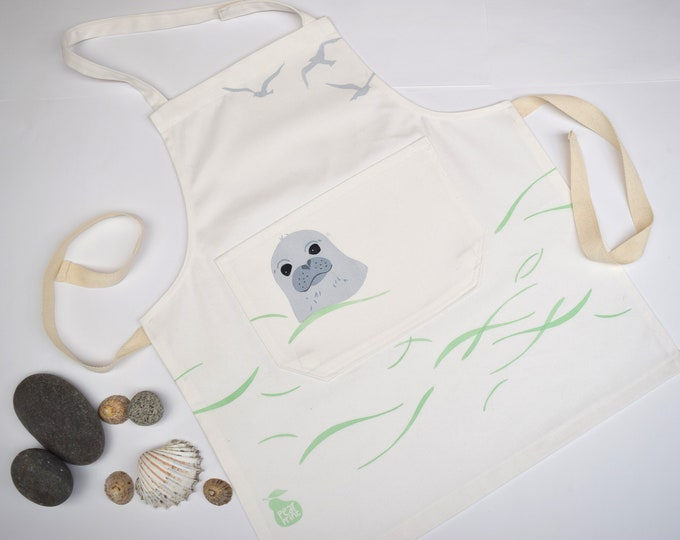 Childs apron, baby seal swimming in the sea, organic cotton, hand printed and hand made in Wales
