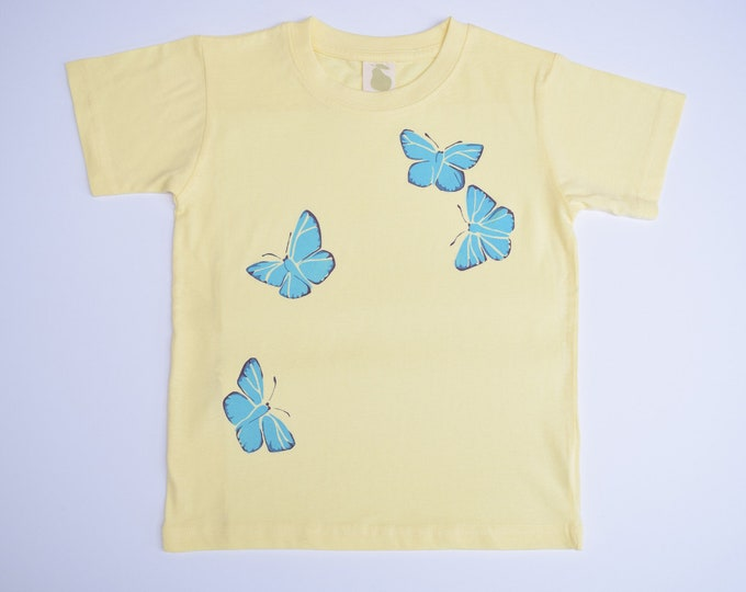 Blue butterfly toddler T shirt. Printed on the back too!