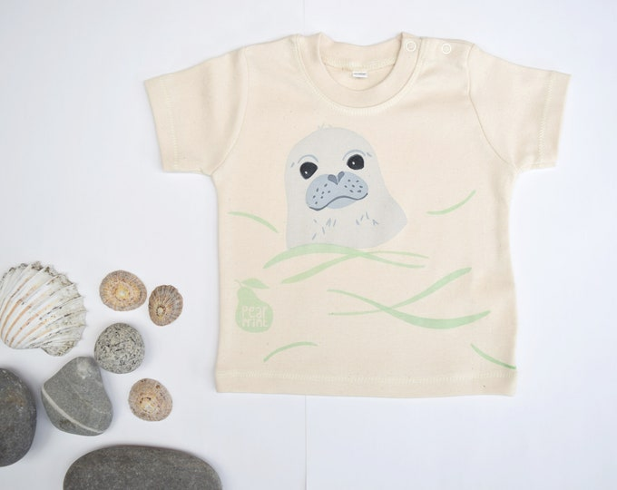 PearPrint baby t-shirt in organic cotton with a swimming seal pup. Baby boy or baby girl gift.