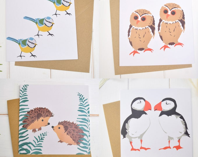 4 PearPrint greetings cards, one each of owls, pffins, bluetits and hedgehogs.