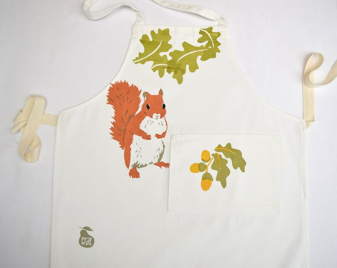 Childs apron, imperfect print, red squirrel, oak leaves and acorns, organic cotton, hand printed and hand made in Wales