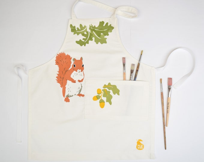 Childs apron, red squirrel, oak leaves and acorns, organic cotton, hand printed and hand made in Wales