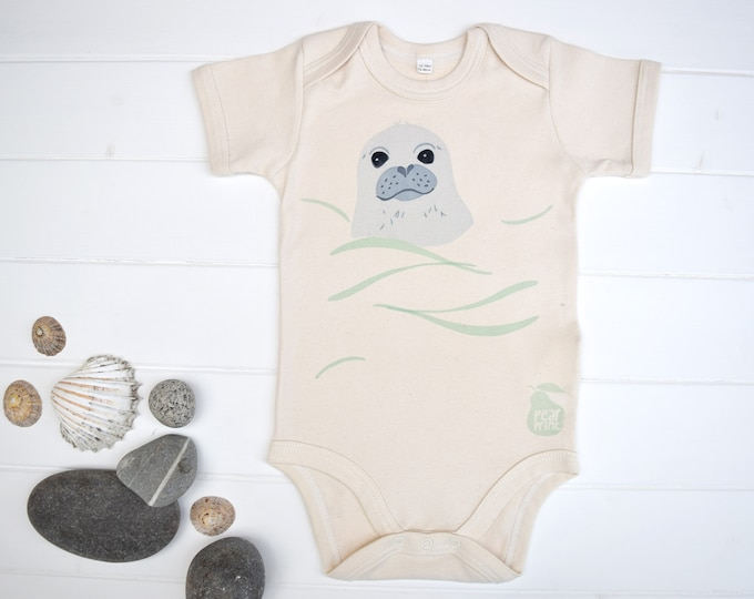 Baby bodysuit in organic cotton with a swimming seal pup, water baby, baby boy or baby girl gift.