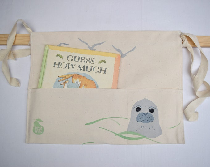 Bed tidy with swimming seal pup and seagulls. Bunk bed caddy. Cot caddy. Kids book holder.