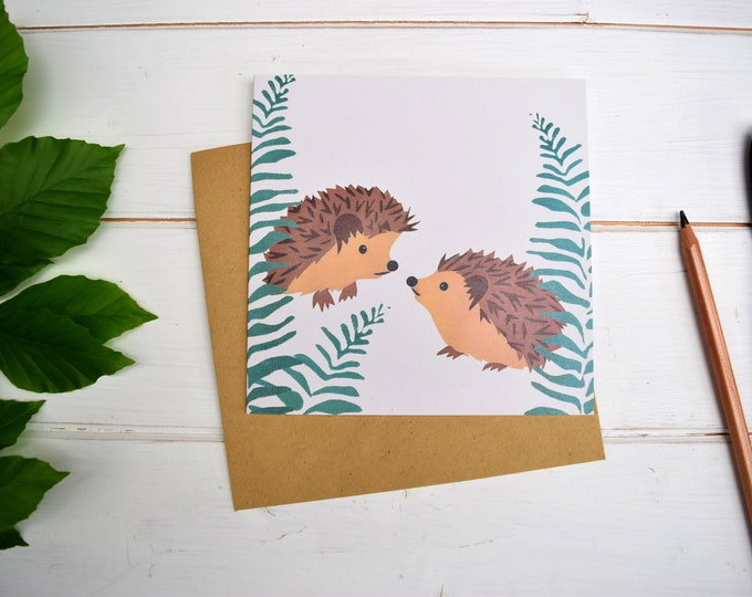 Hedgehogs and ferns greetings card.