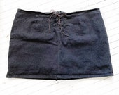 Plus size stretch black lace up denim skorts. Size 28.