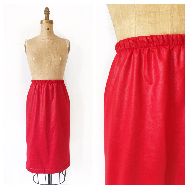 Red leather look high waisted pencil skirt with elastic waistband Size M.