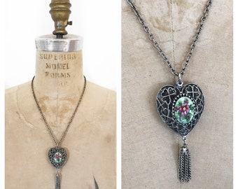 Vintage heart pendant with floral cabochon and tassel.