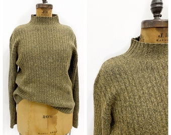 Perfectly slouchy olive wool blend ribbed knit sweater. Size XL.