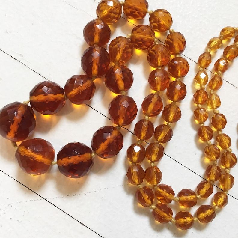 Art Deco hand knotted ombr\u00e9 amber Czech hand cut window pane crystal long necklace.