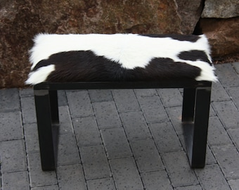 Modern bench upholstered with steel and fur cover