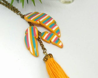 Long boho style feather necklace with multicolor lines and mustard tassel made of polymer clay, unique artisan jewellery, statement necklace