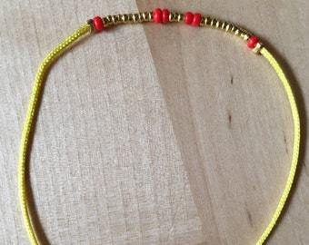 Adjustable cord bracelet
