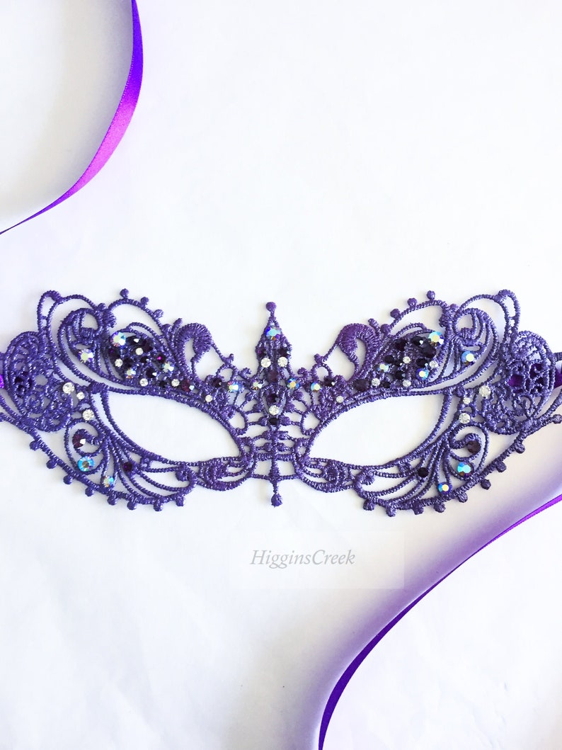 purple woman masquerade mask with vibrant shades of purple image 0