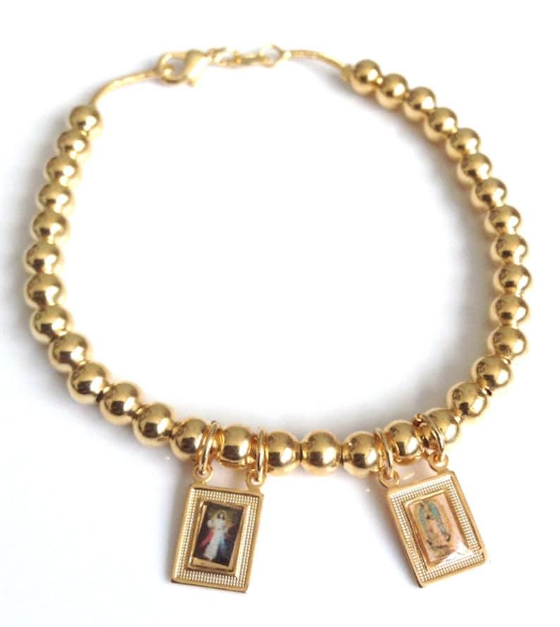 1496829ab5e3 Pulsera de balin banada en oro con imagen de la Divina