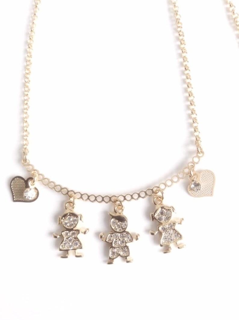 bffc8e7abeb0 Boy and Girl Charms necklace Cadena bañana en oro con dijes