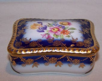 REDUCED! Beautiful Fine Bone China Royal Blue Trinket Box. Decorated with Flowers and Trimmed with Gold. Excellent Condition.