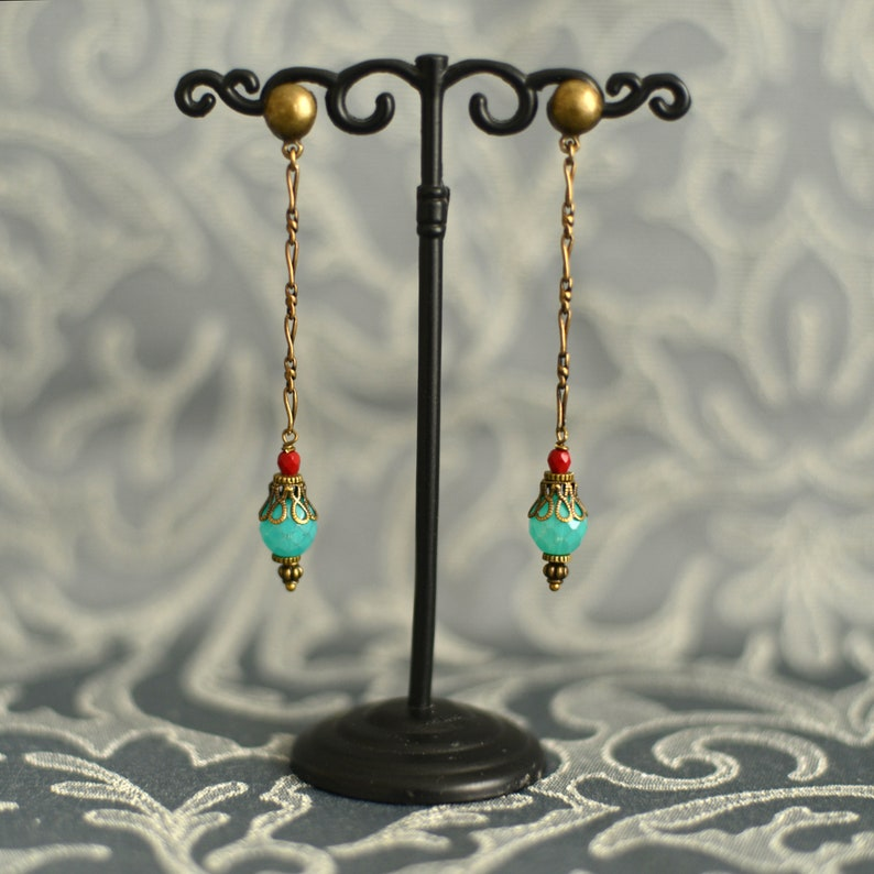 Orisha Blue and red glass and brass ear pendants