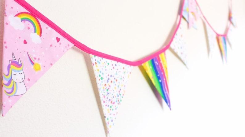 Unicorn & rainbow bunting bright pink girl's fabric image 0