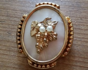 1930s WINE LOVER BROOCH, gold bunch of grapes and vine leaves with faux pearls and lucite mother of pearl style background, trombone clasp.