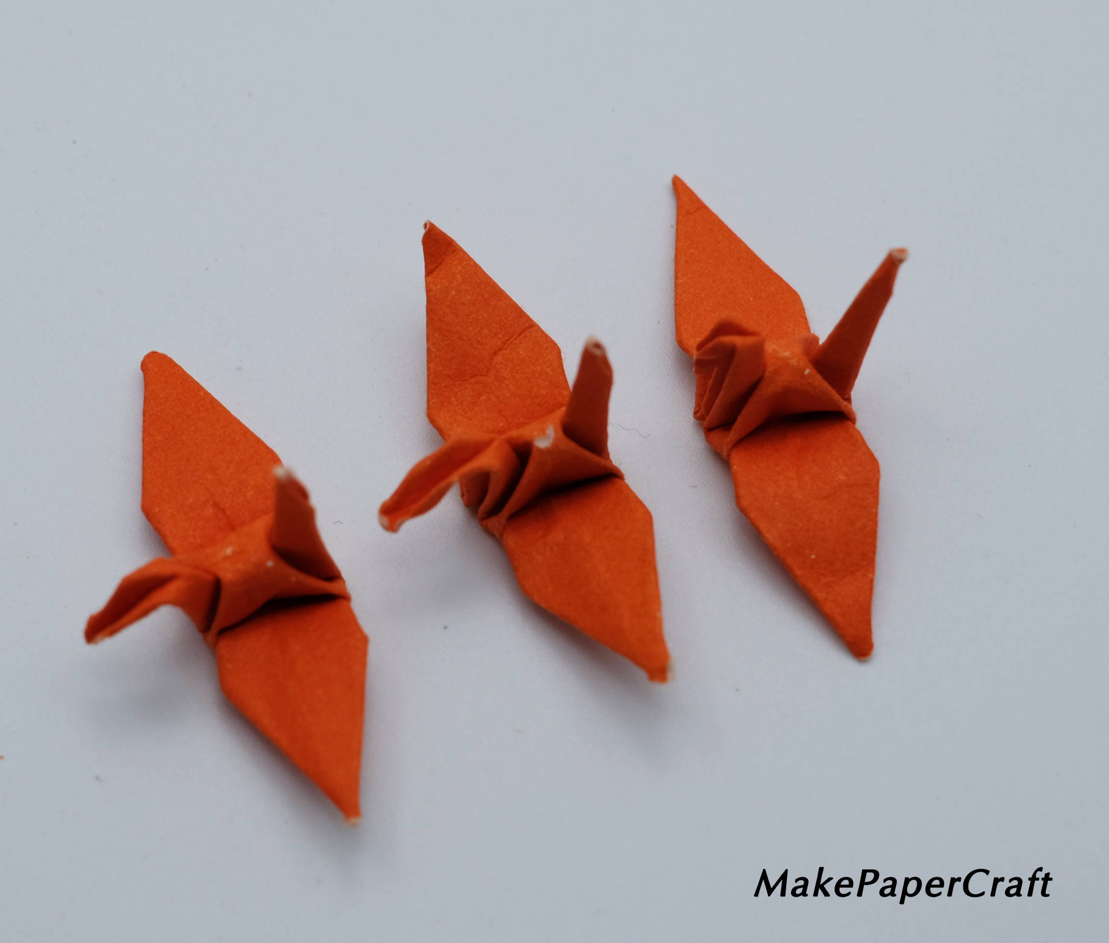 Matching earrings and necklace set in light orange and white origami paper