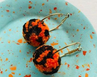 Handmade orange & black pom pom hoop earrings