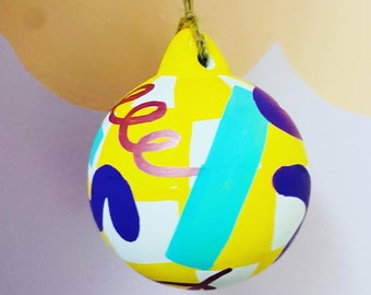Colourful hand painted ceramic Christmas baubles