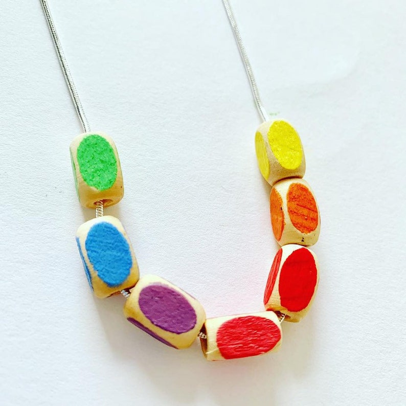 minimal style wooden statement necklace in rainbow colours. Geometric bead
